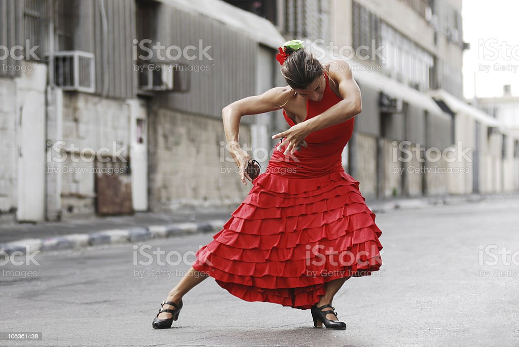 Female flamenco dancer doing a pose in an alley stock photo