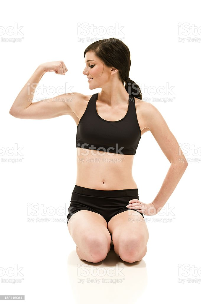 Female flexing muscles royalty-free stock photo