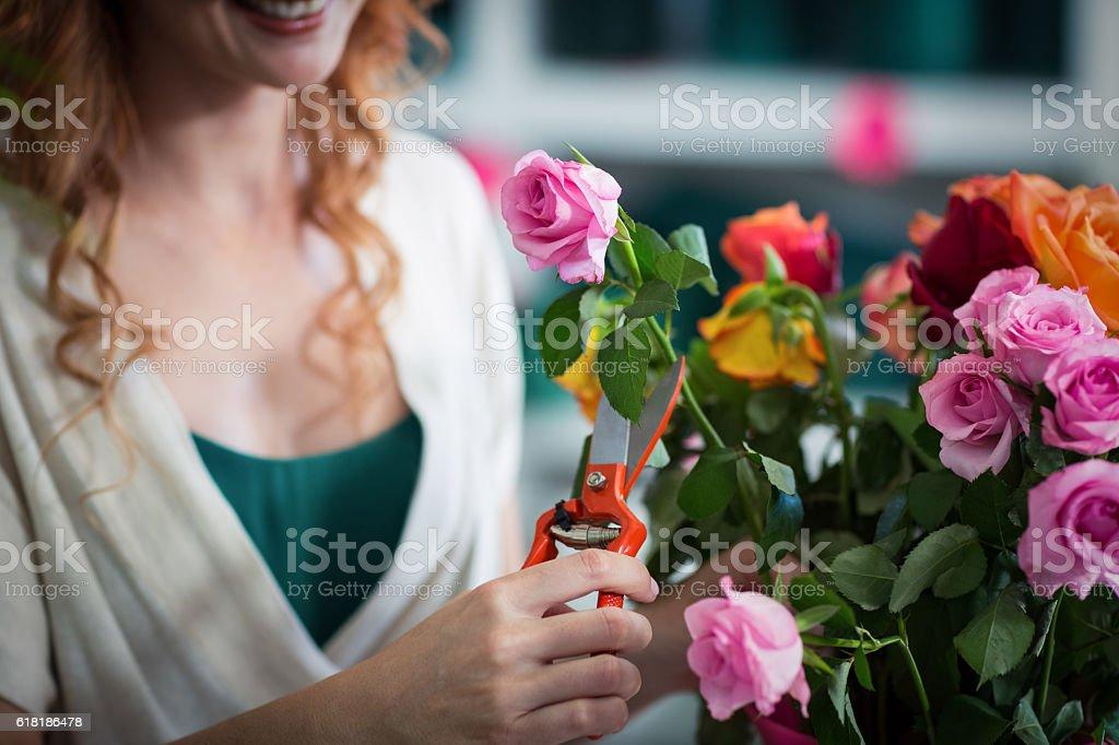 Female florist preparing flower bouquet stock photo