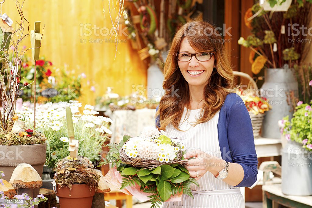 Female Florist Small Business Flower Shop Owner stock photo