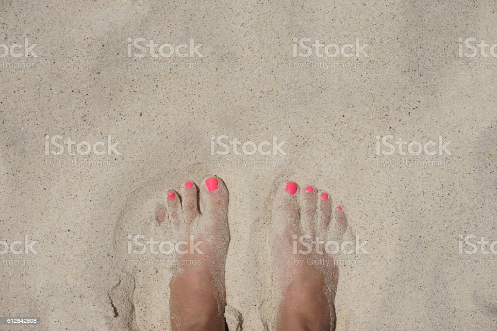 female foot on the beach stock photo