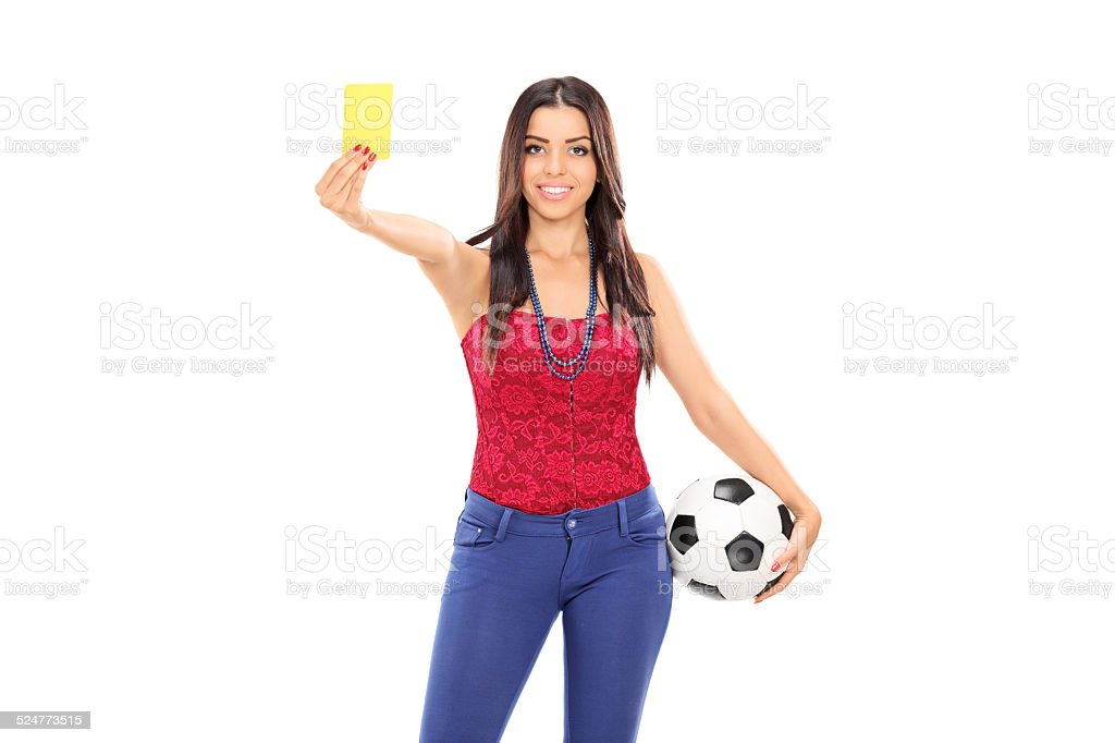 Female football fan showing a yellow card stock photo