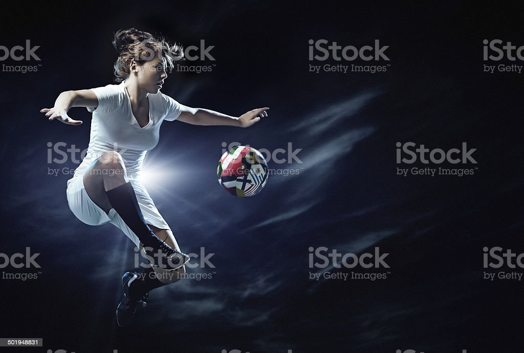 female football player in action stock photo