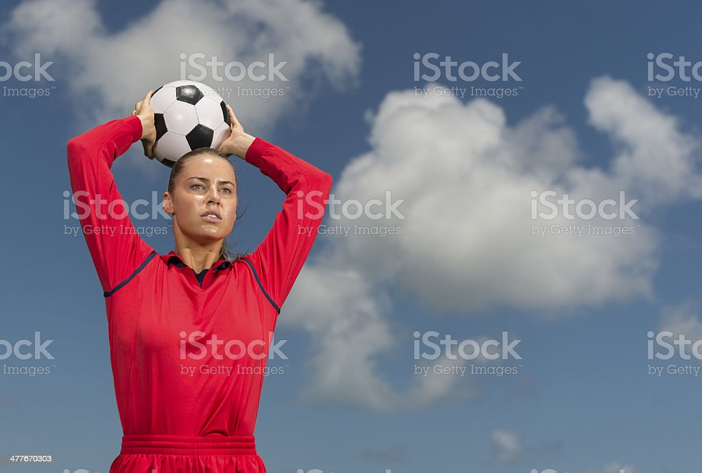Female Footballer In Action stock photo