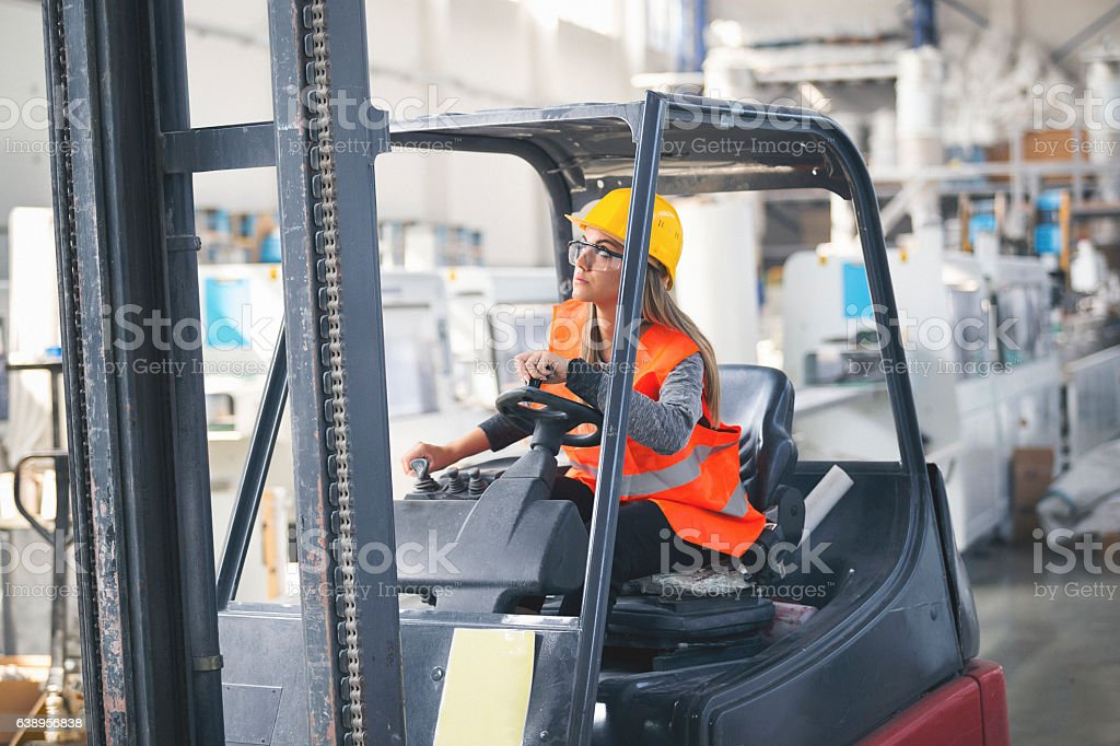 Female forklift operater stock photo