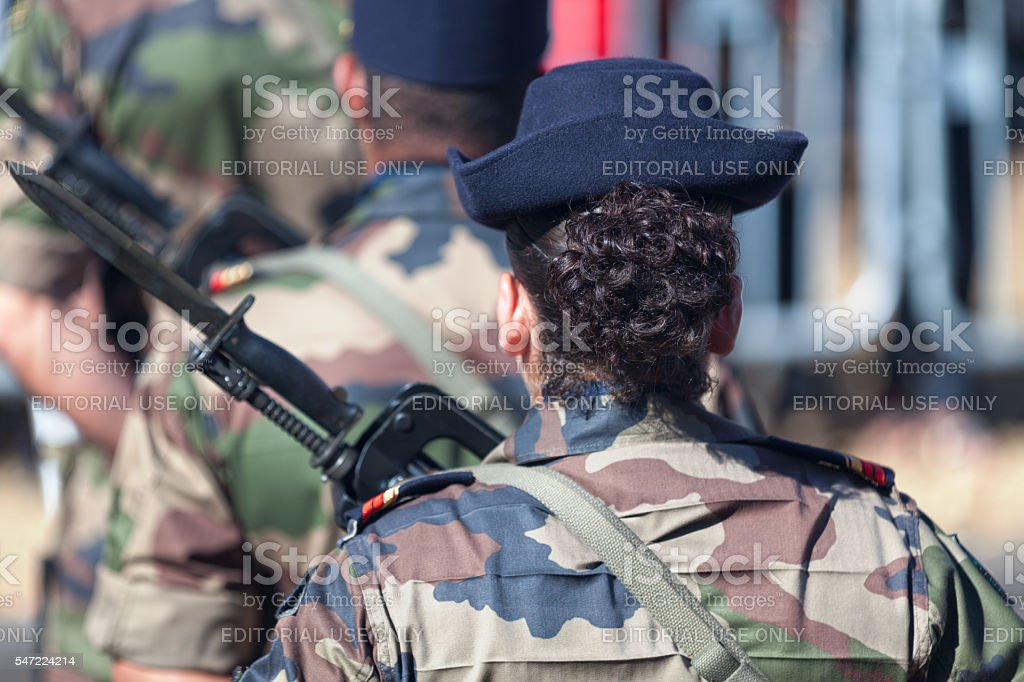 Female French soldier parading stock photo