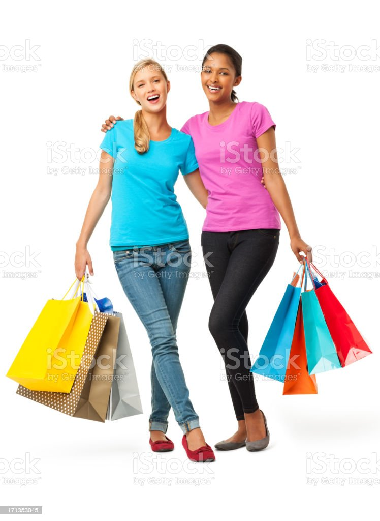 Female Friends Carrying Shopping Bags - Isolated stock photo