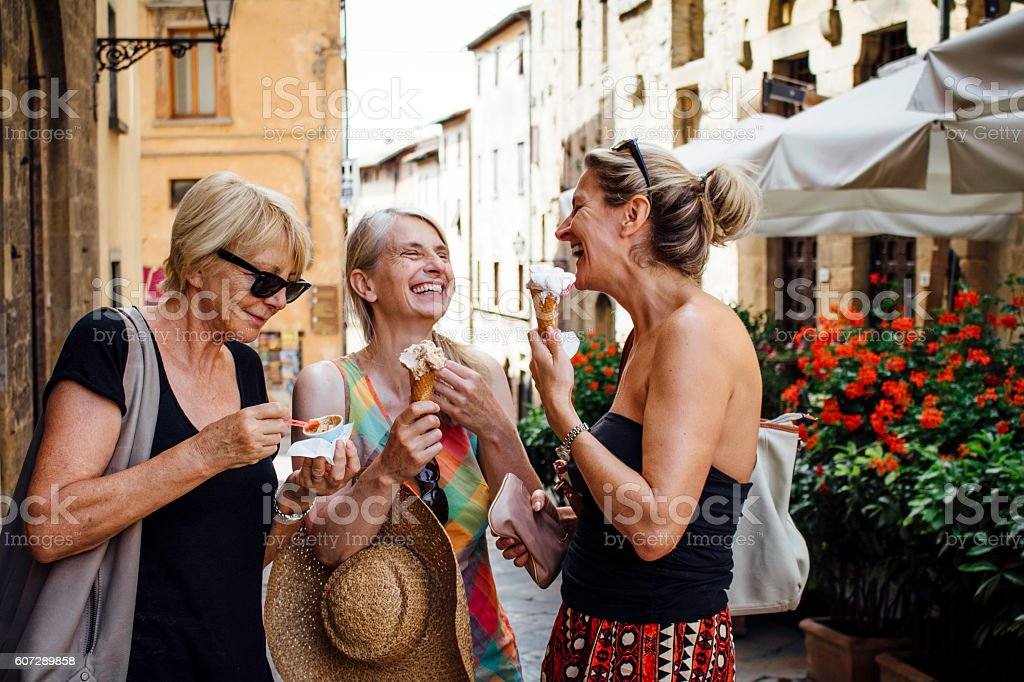 Female Friends Enjoying Italian Ice-Cream stock photo
