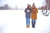 Female friends enjoying snowy day outside
