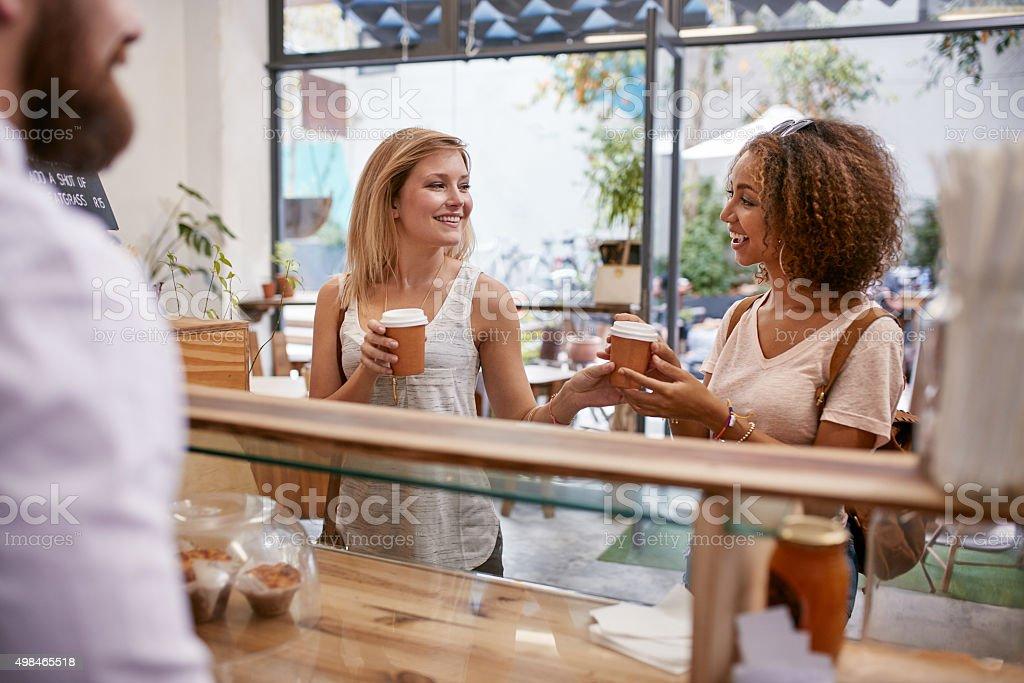 Female friends having coffee stock photo