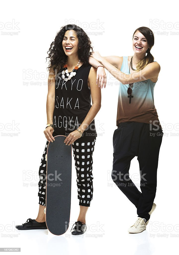 Female friends holding skateboard royalty-free stock photo