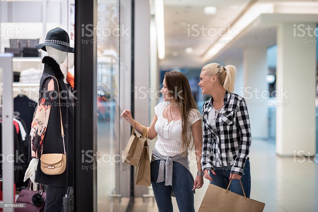 Female friends in shopping mall stock photo