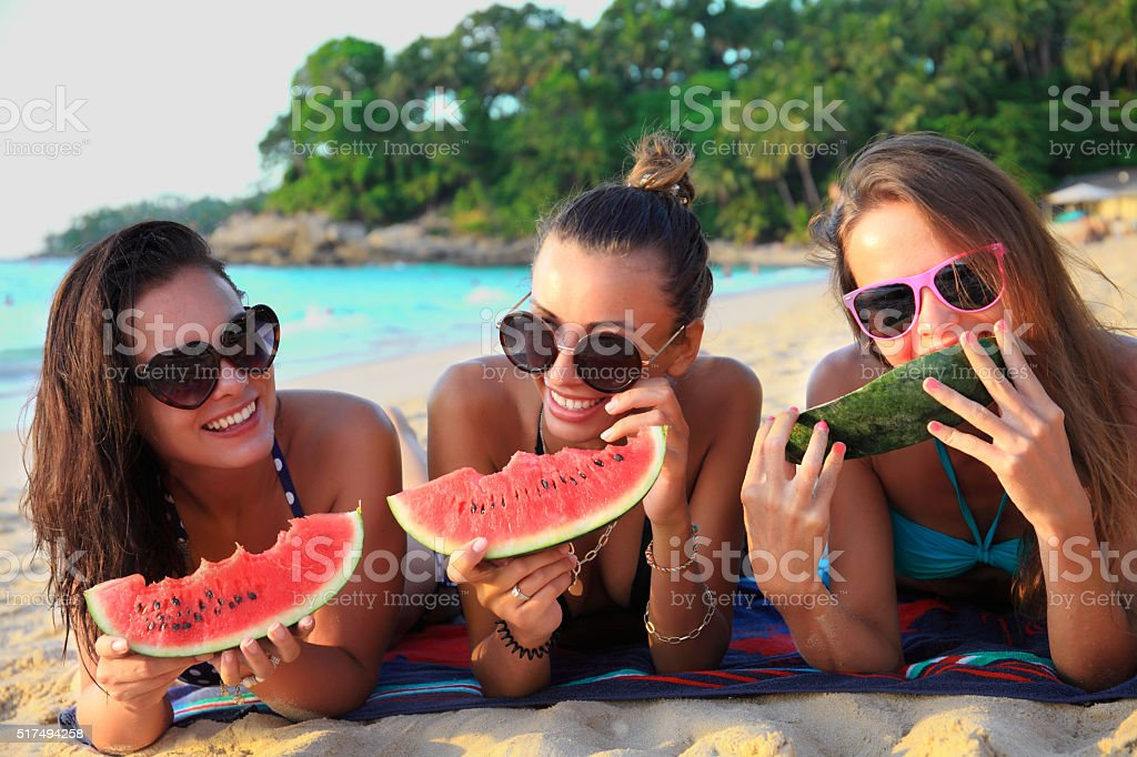 Female friends on beach stock photo