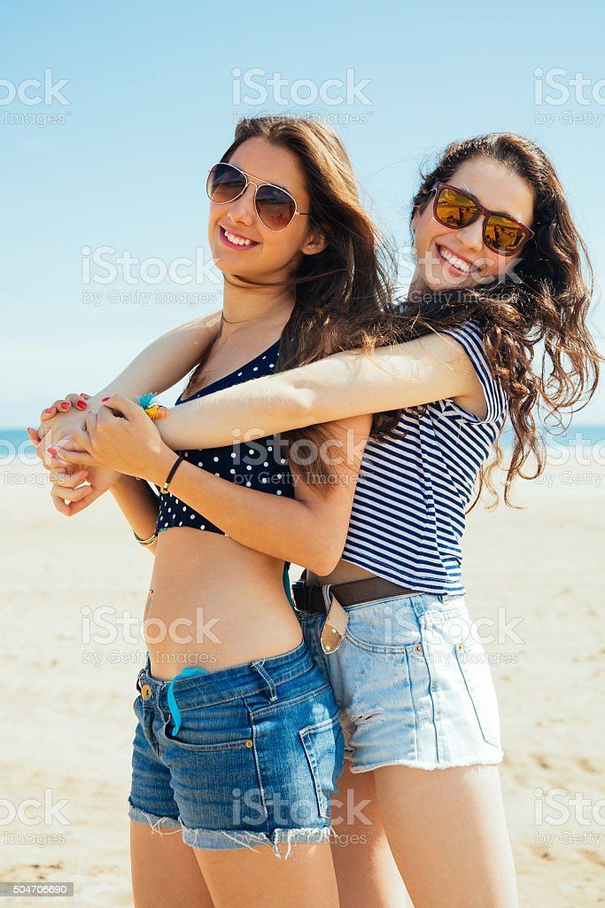 Female friends on the beach stock photo