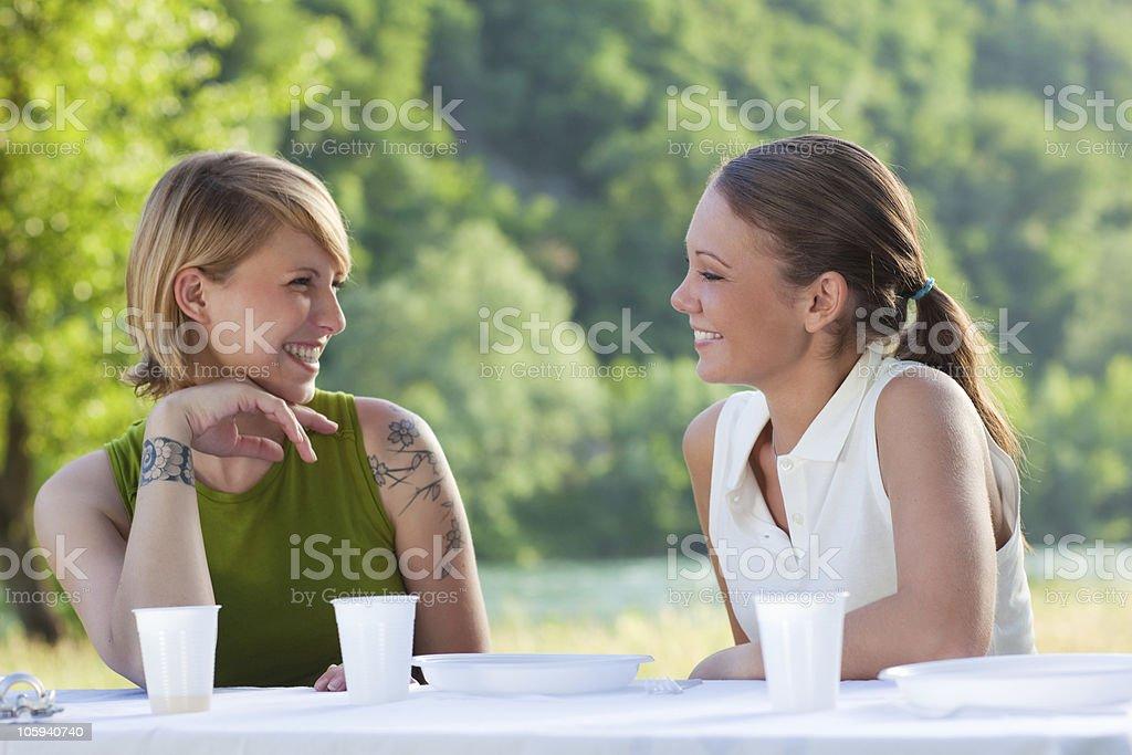 female friends picknicking royalty-free stock photo