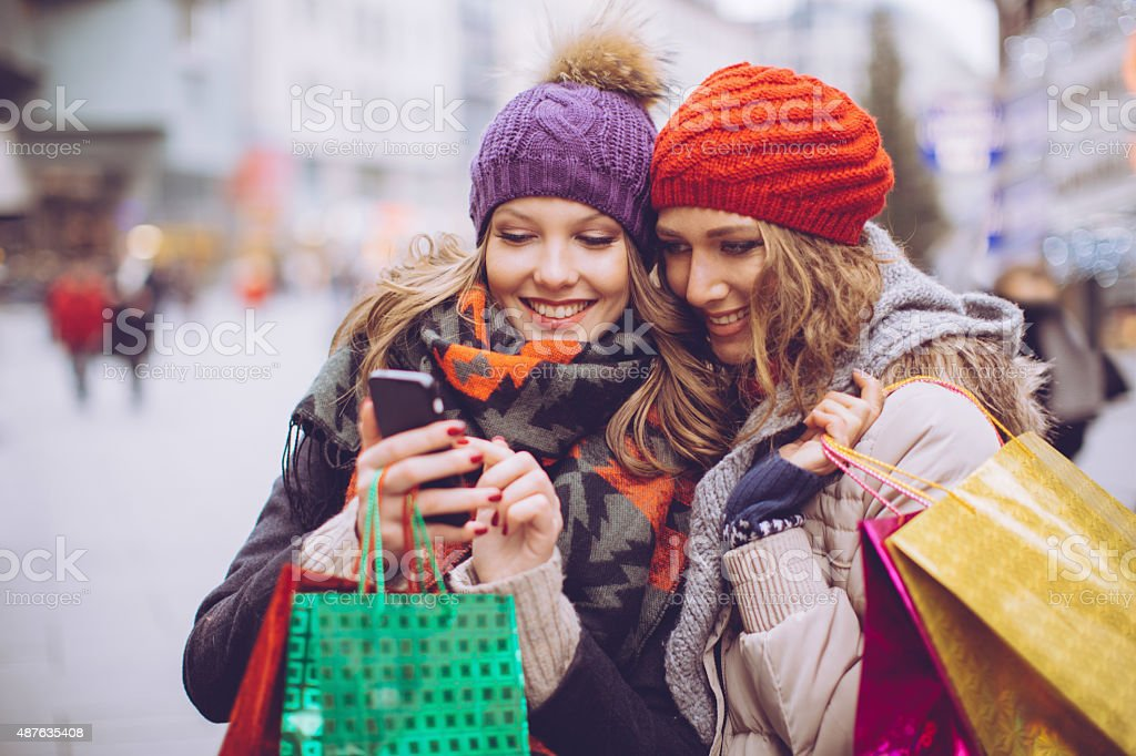 Female friends shopping in city. stock photo