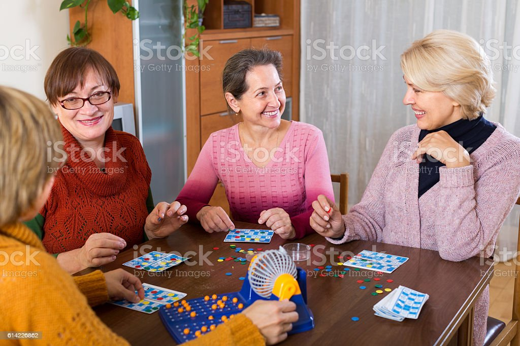 female friends sitting with lotto stock photo