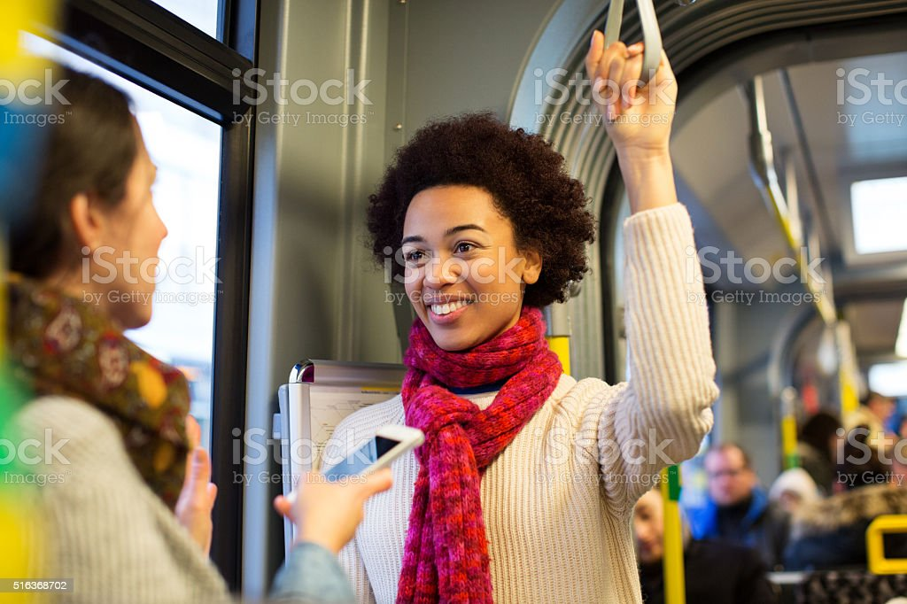 Female friends traveling by train stock photo