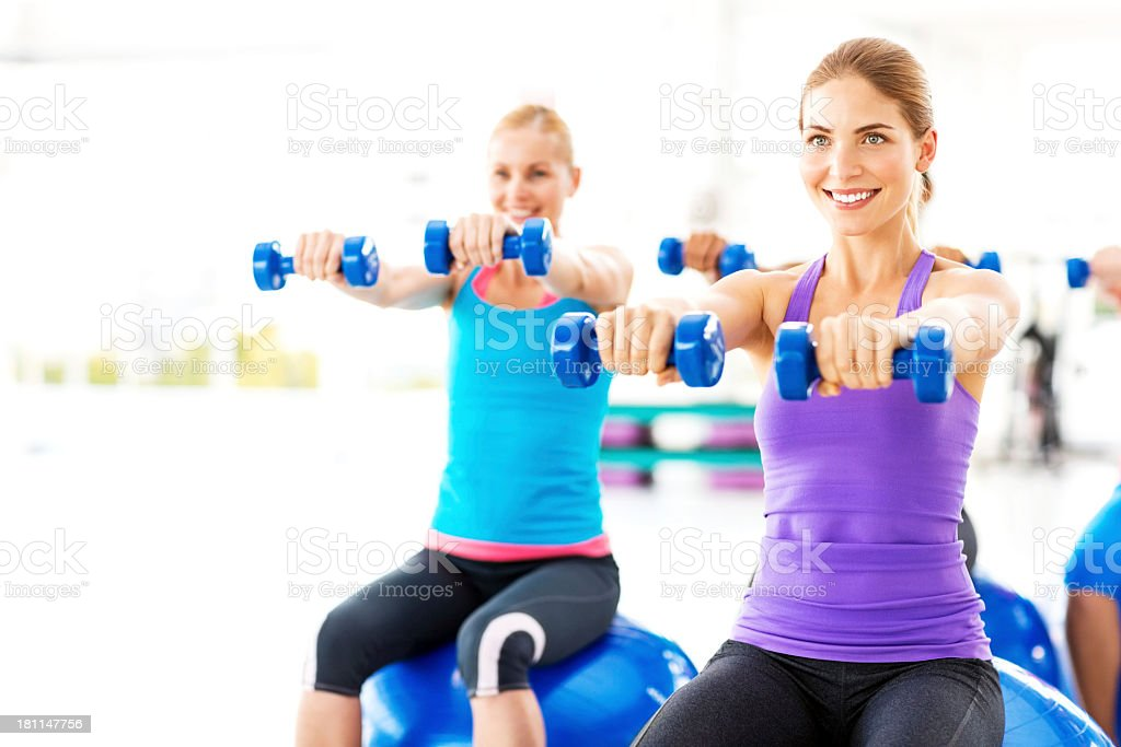 Female Friends Working Out At Health Club royalty-free stock photo