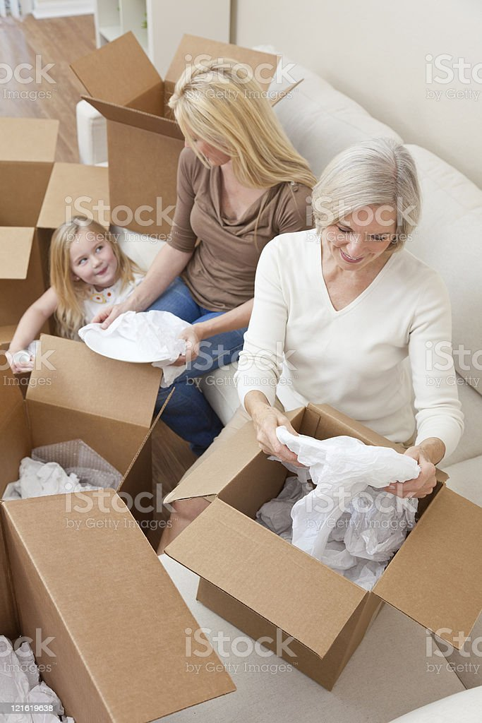 Female Generations of Family Unpacking Boxes Moving House royalty-free stock photo