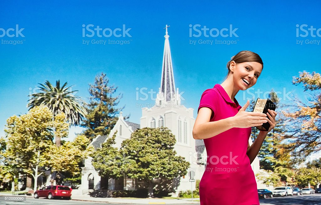 Female gesturing to go church with her hand stock photo