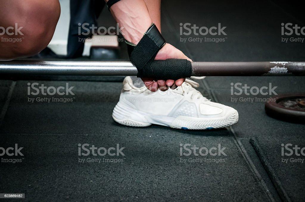 Female get ready for deadlift exercise stock photo