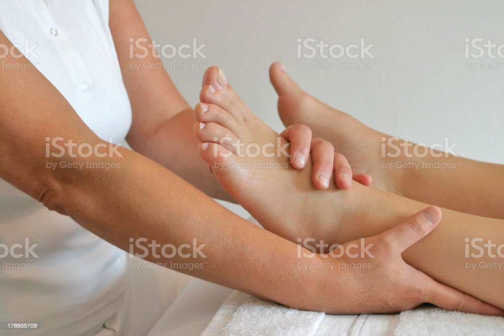 Female getting a foot massage on her left foot  royalty-free stock photo