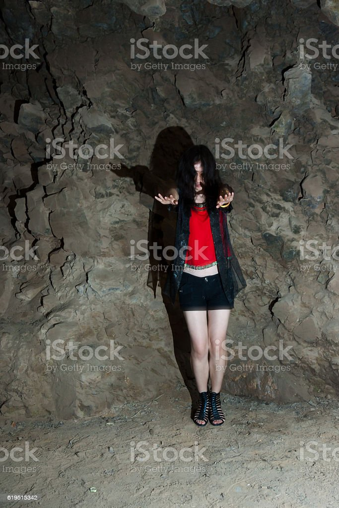 female ghost in the cave stock photo