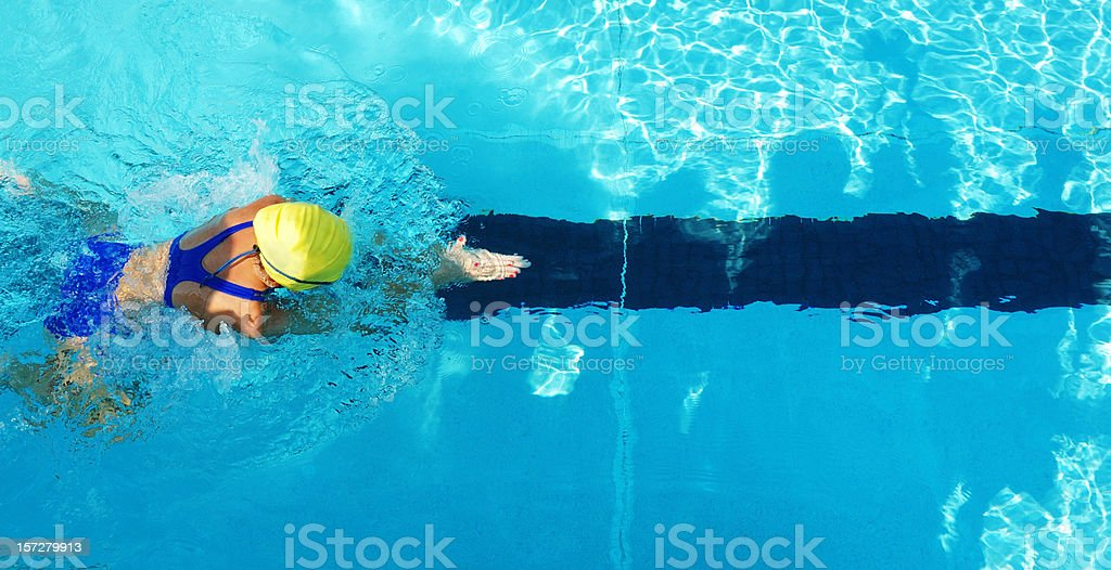 Female Girl Breaststroke Swimmer from Above in Swimming Pool stock photo