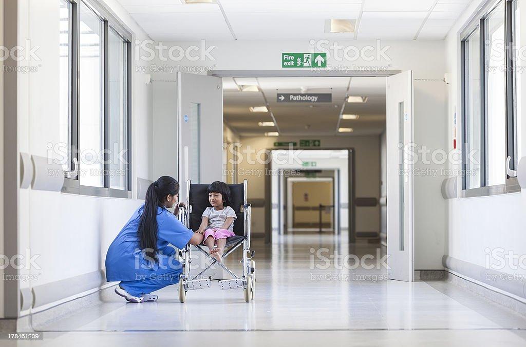 Female Girl Child Patient in Wheelchair & Hospital Nurse stock photo