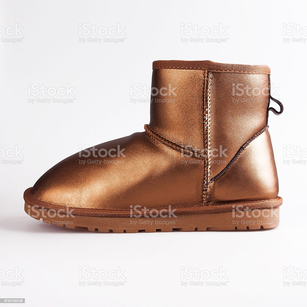 female gold boots over white stock photo