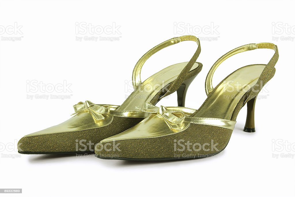 female gold shoes stock photo