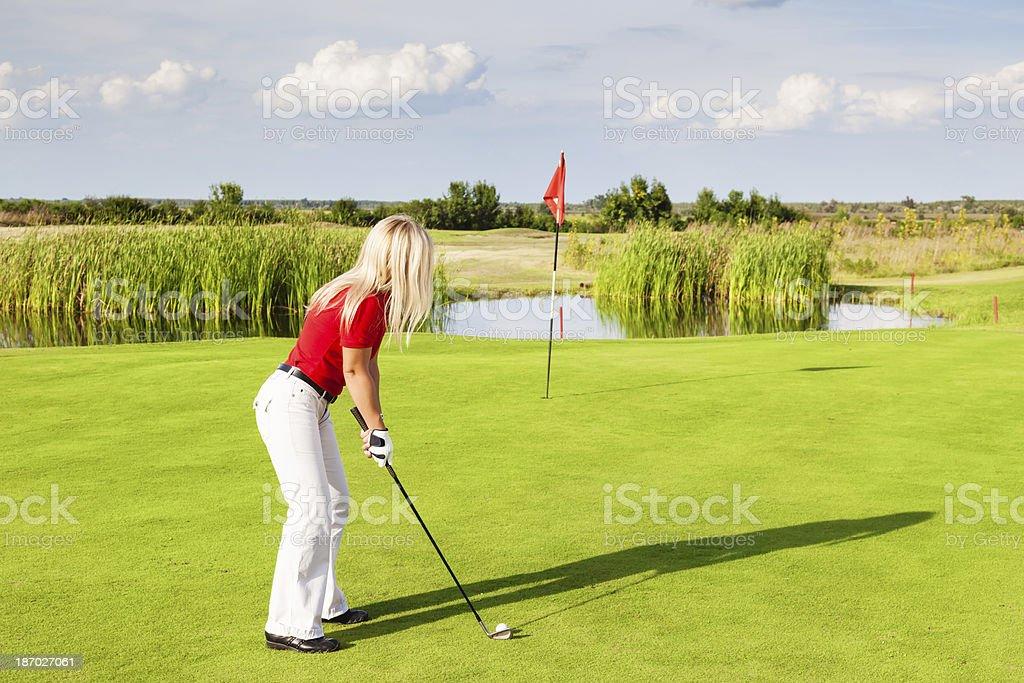 Female golf swing royalty-free stock photo