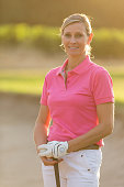 female Golfer portrait on sunset with flares