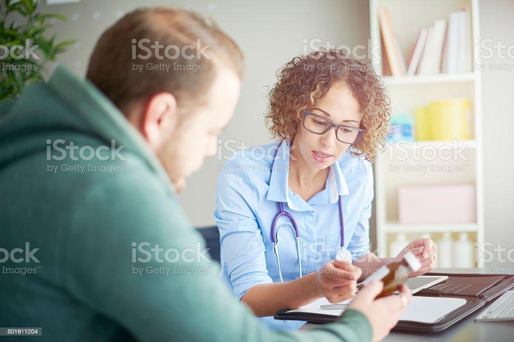 female gp medicine advice stock photo
