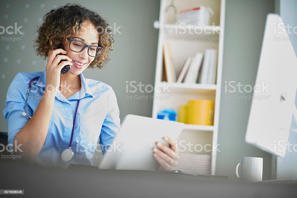 female gp tablet time stock photo
