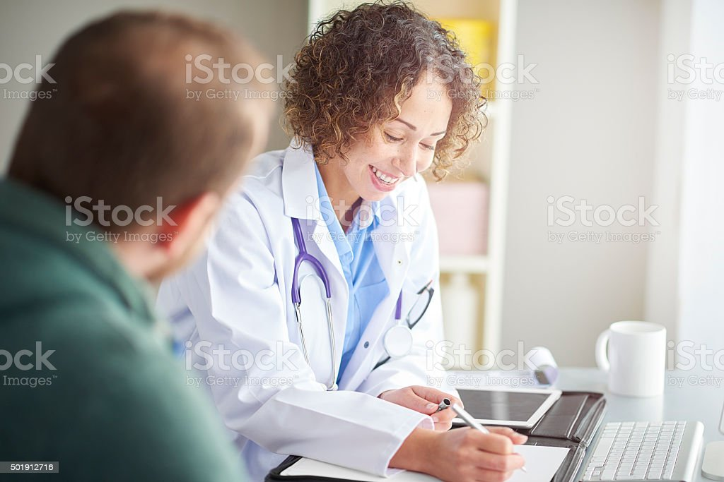 female gp writing a prescription stock photo