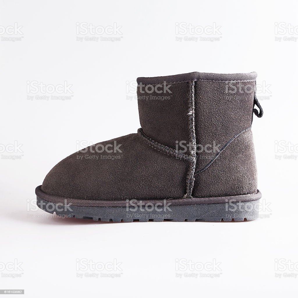 female gray boots over white stock photo