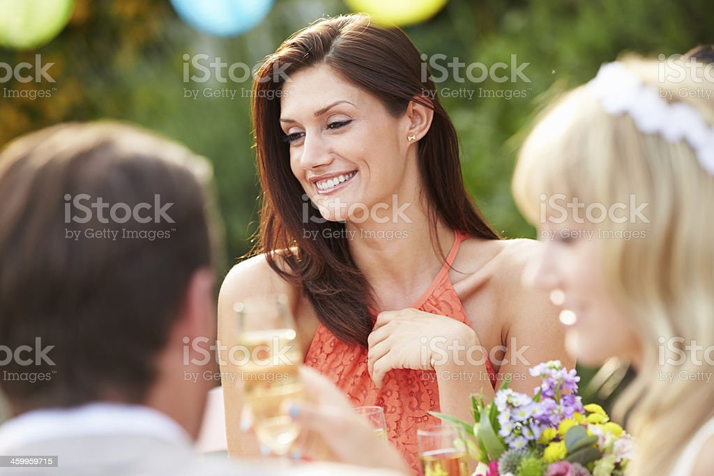 Female Guest At Wedding Reception stock photo