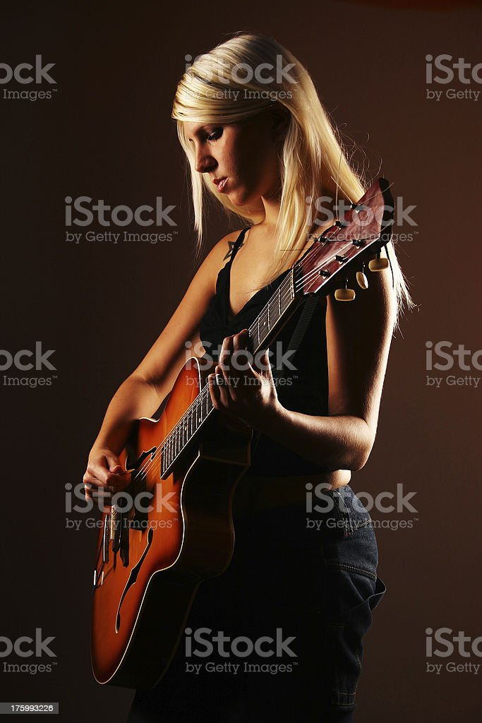Female guitar player royalty-free stock photo