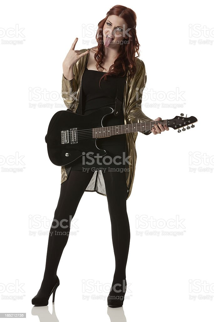 Female guitarist with tongue out stock photo