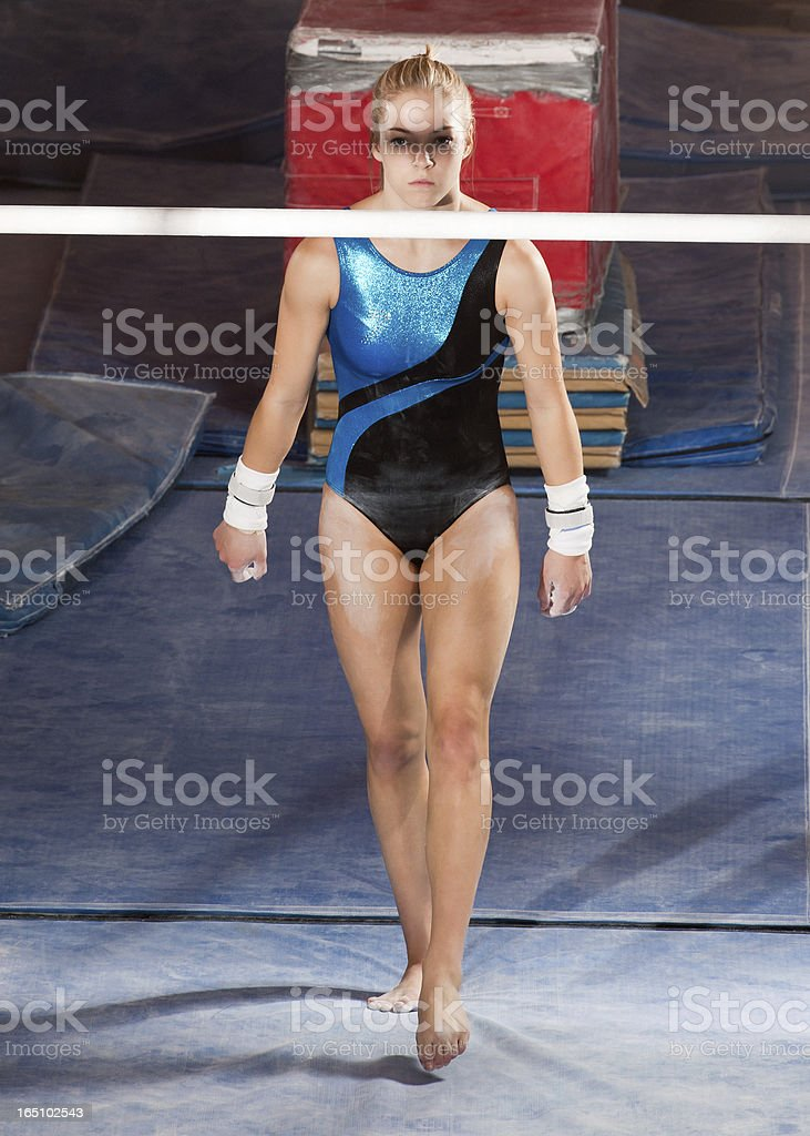 Female Gymnast Approaches the Bar royalty-free stock photo