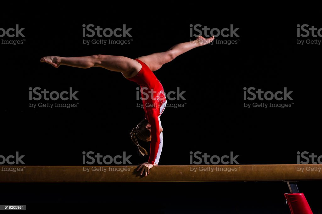 Female gymnast in sports hall stock photo