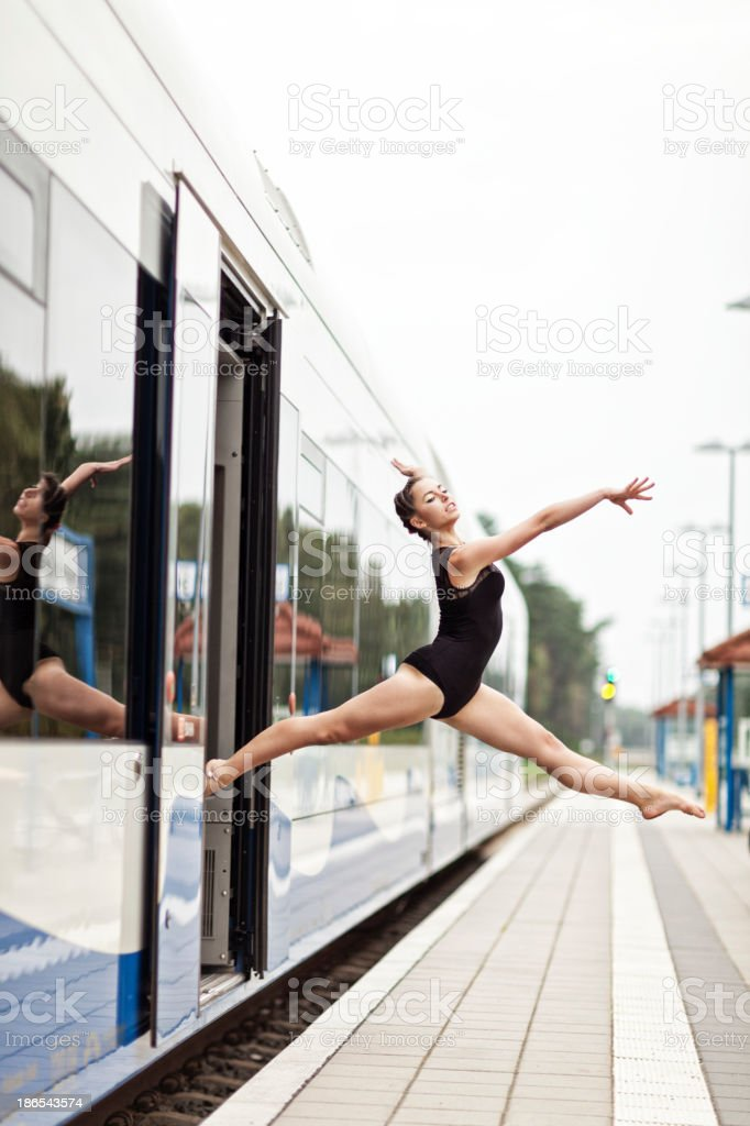 Female Gymnast Jumping Off Train stock photo