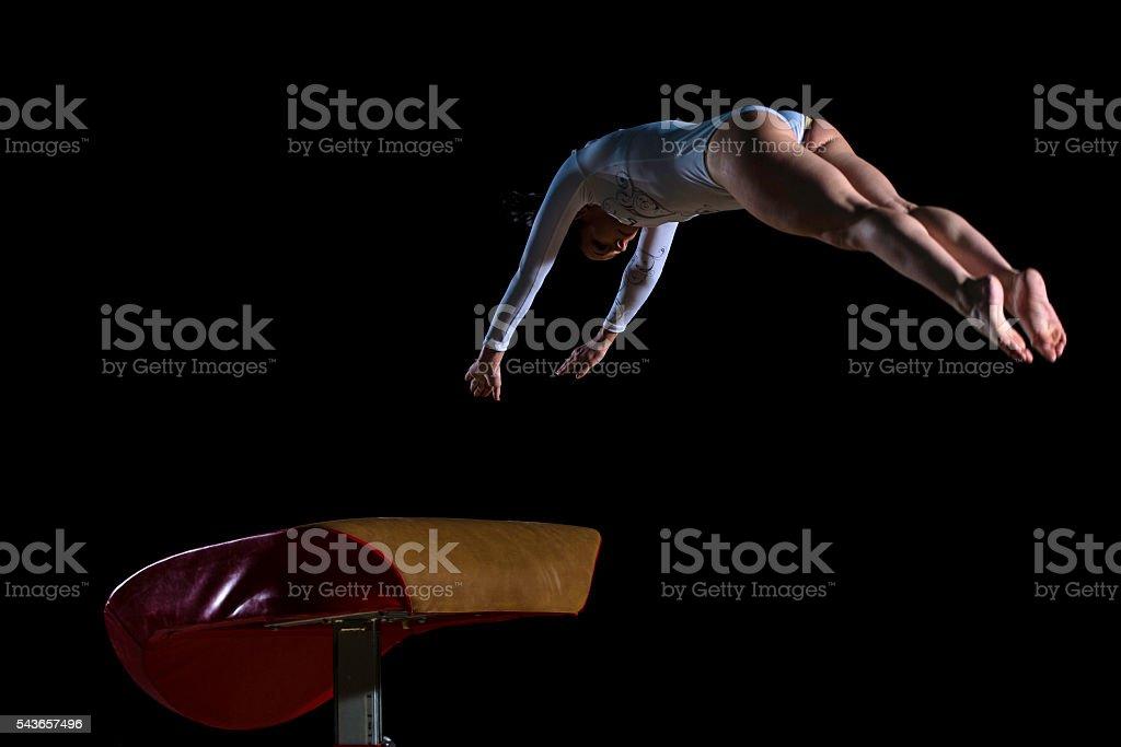 Female gymnast on vaulting horse stock photo