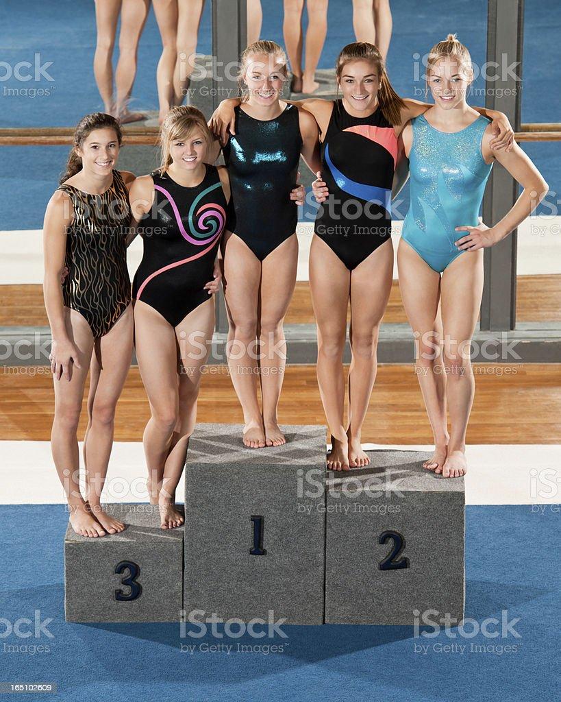 Female Gymnasts On Medal Podium royalty-free stock photo