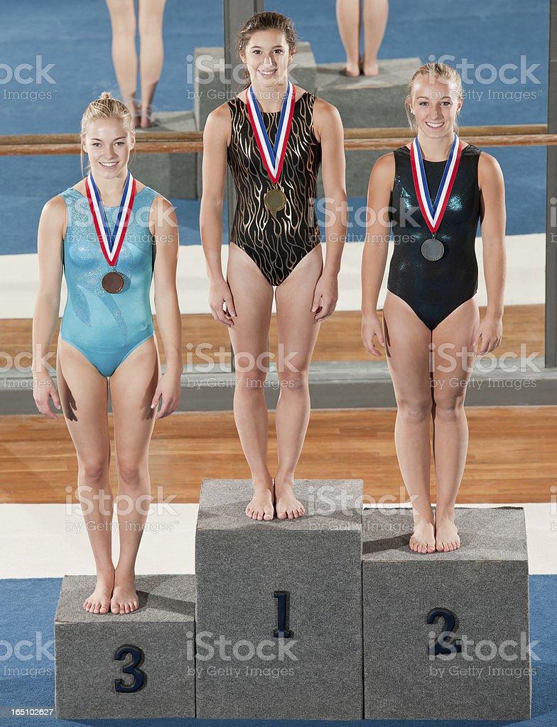 Female Gymnasts On Winner Podium stock photo