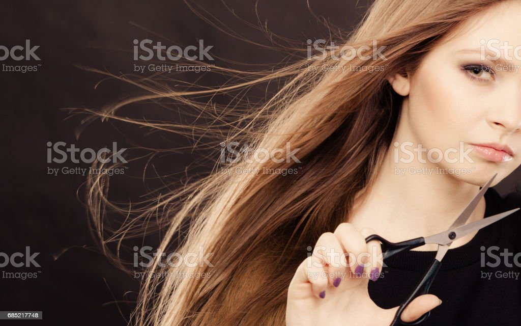 Female hairstylist barber with scissors. stock photo