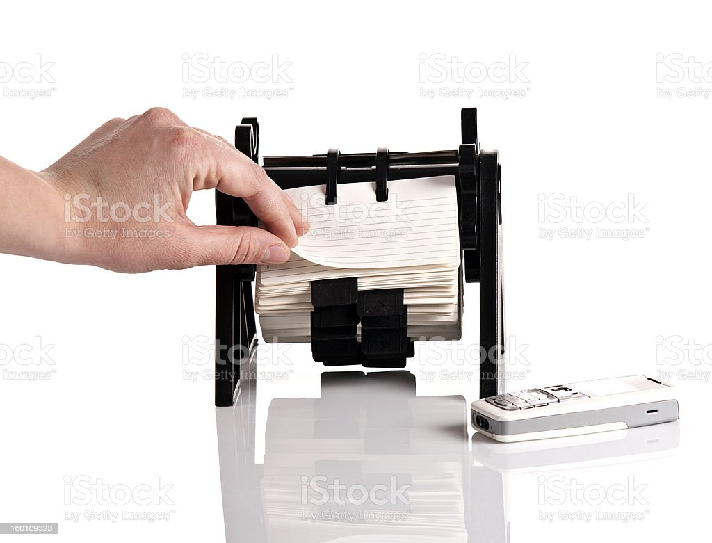 Female hand bronsing rotary card organizer royalty-free stock photo