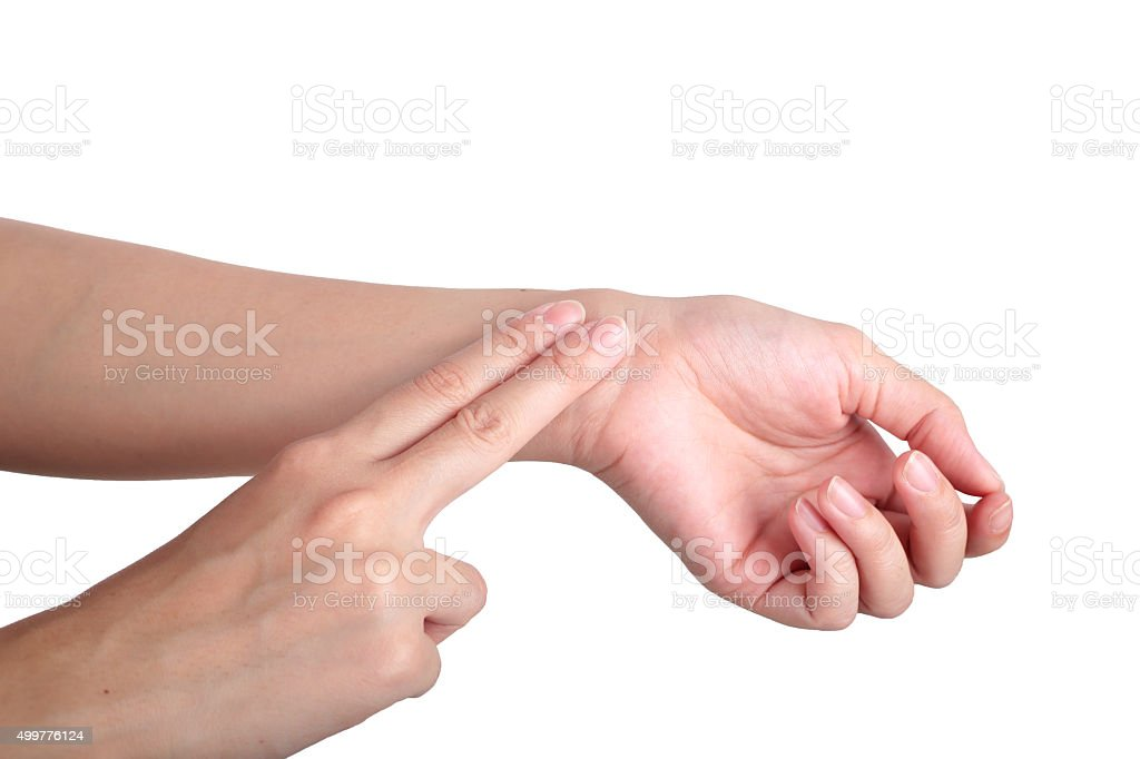 Female hand checking pulse on white background. stock photo